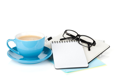 Blue coffee cup, glasses and office supplies. Isolated on white background photo