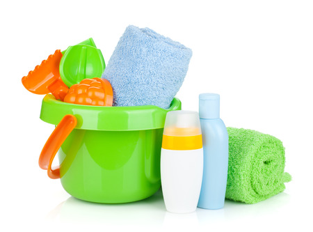 Beach baby toys, towels and bottles. Isolated on white background photo
