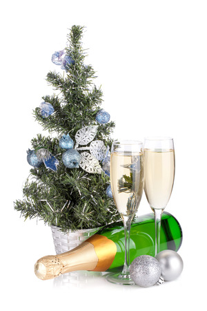 Champagne, firtree and christmas decor. Isolated on white  photo