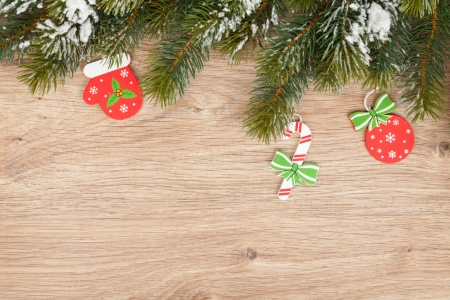 Christmas fir tree and decor on wooden board photo