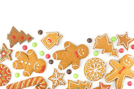 Homemade various christmas gingerbread cookies on white  photo