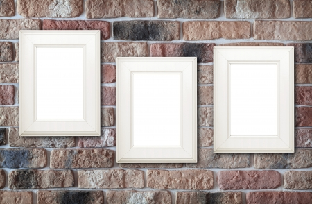 Photo frames on brick wall  photo