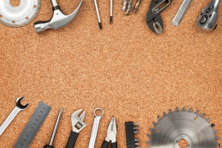 Set of tools on cork panel background with copy space photo