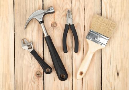 Set of tools on wood panel background photo
