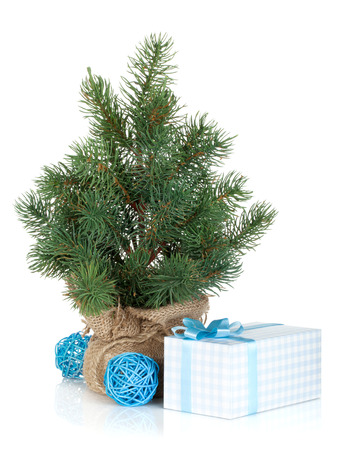 Fake mini Christmas tree with decoration and gift box. Isolated on white background photo