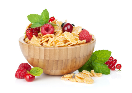 Fresh corn flakes with berries in bowl. Isolated on white  photo