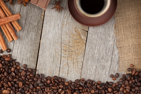 coffee sack: Coffee cup, spices and chocolate on wooden table texture with copy space. View from above Stock Photo