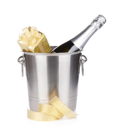 Champagne bottle in bucket and gift box. Isolated on white background photo