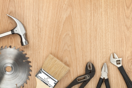 Set of tools on wood panel background with copy space photo