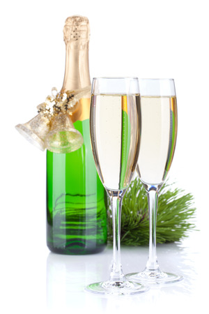 Champagne bottle, glasses and christmas decor. Isolated on white background photo