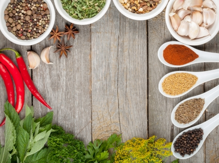 Colorful herbs and spices selection. Aromatic ingredients on wood table with copyspace Stock Photo