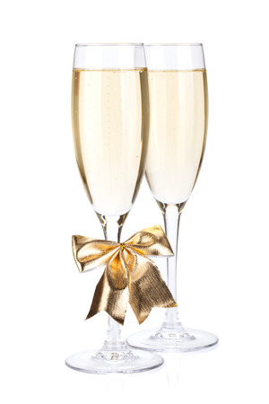 Champagne glasses with bow decor. Isolated on white background photo