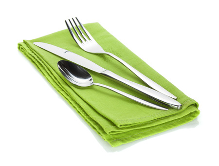 flatware: Silverware or flatware set of fork, spoon and knife on towel  Isolated on white background