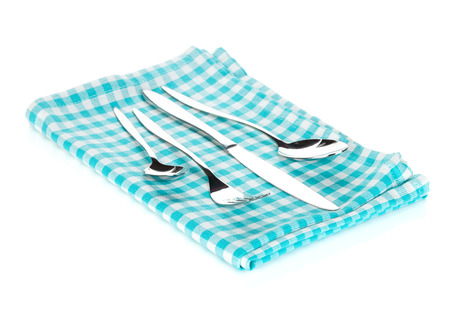 Silverware or flatware set of fork, spoons and knife on towel. Isolated on white