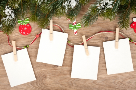 Blank christmas picture frames with fir tree and decor Stock Photo