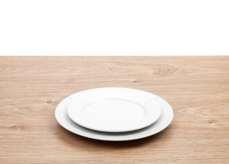 setting table: Empty plates on wooden table