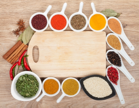 Various spices selection on wooden table photo