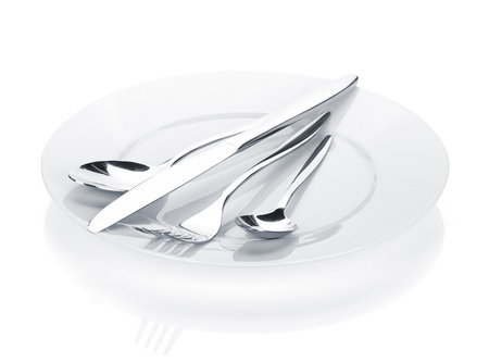 flatware: Silverware or flatware set of fork, spoons and knife over plates. Isolated on white