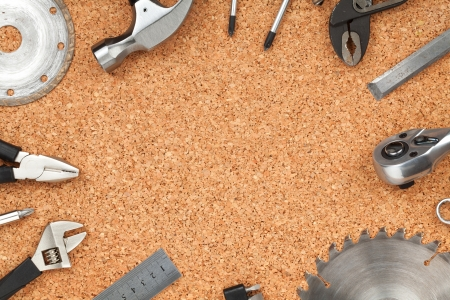 carpenter items: Set of tools on cork panel with copy space