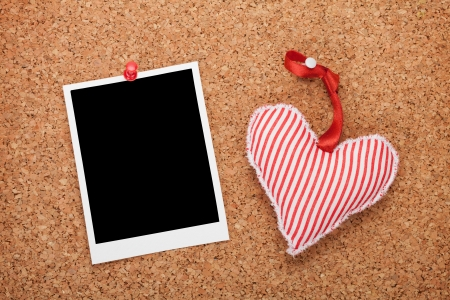 Blank instant and red heart. On cork wooden  photo