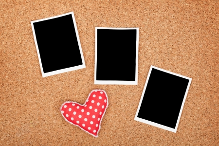 Polaroid photo frames on cork texture background with handmaded heart Stock Photo - 25190630