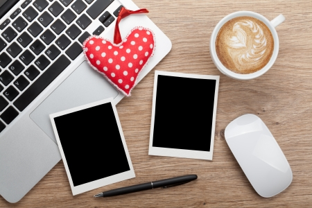 Valentines day blank photo frames and toy heart over office workplace photo