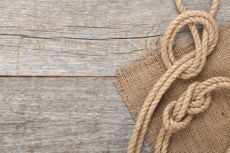 burlap sack: Ship rope on old wooden texture background with copy space