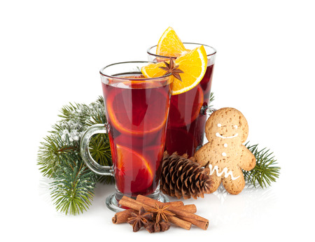 Christmas mulled wine with spices and snowy fir tree. Isolated on white background photo