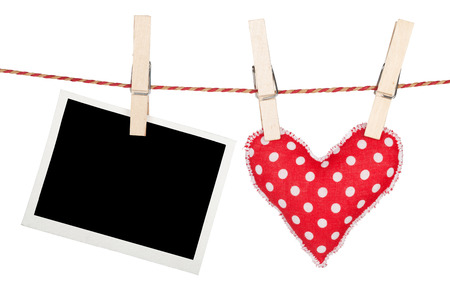 Blank instant photo and red heart hanging. Isolated on white background photo