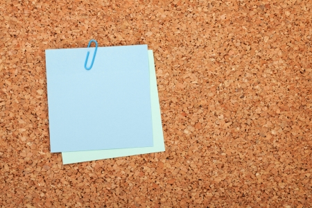 Blank postit note on cork wood notice board with copy space photo
