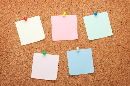 Blank postit notes on cork wood notice board photo