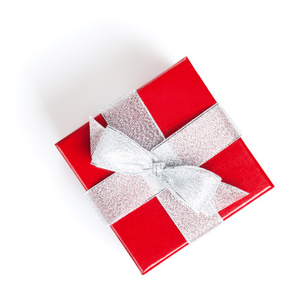 Red gift box with silver ribbon. Isolated on white background. View from above photo