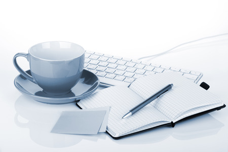 Coffee cup and office supplies photo