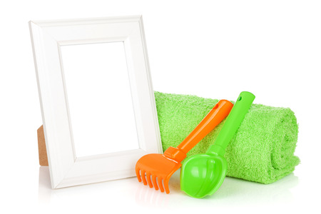 Photo frame with bath towel and toys. Isolated on white background photo