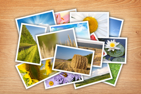 season photos: Stack of printed pictures collage on wooden table
