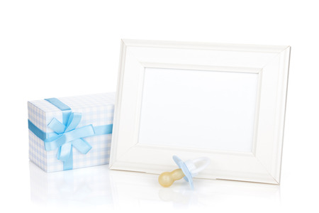 Photo frame with gift box and boy dummy. Isolated on white background photo