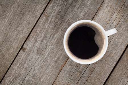 coffee mug: Coffee cup on wooden table. View from above