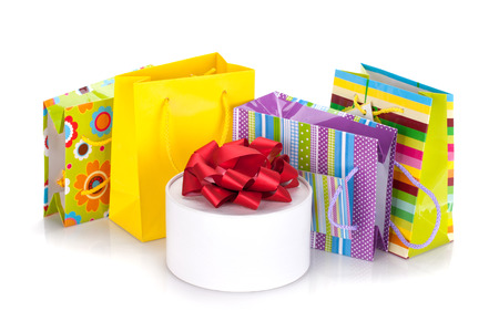 Colored gift bags and box. Isolated on white background photo