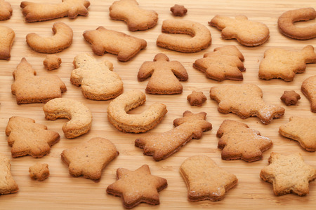 Various gingerbread cookies on wooden table background photo