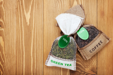 green bean: Coffee and tea small bags on wooden table background with copy space Stock Photo