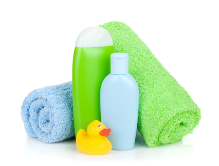 Bath bottles, towel and rubber duck. Isolated on white background