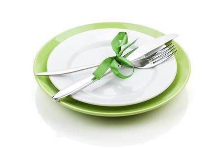 白紙の版上のナイフとフォーク。白い背景に分離 写真素材