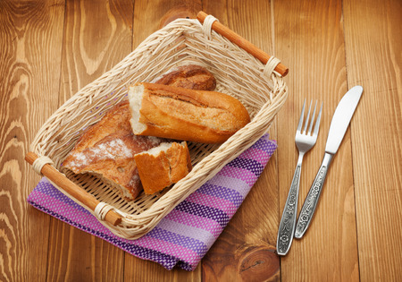 Homemade french bread over wooden table background photo
