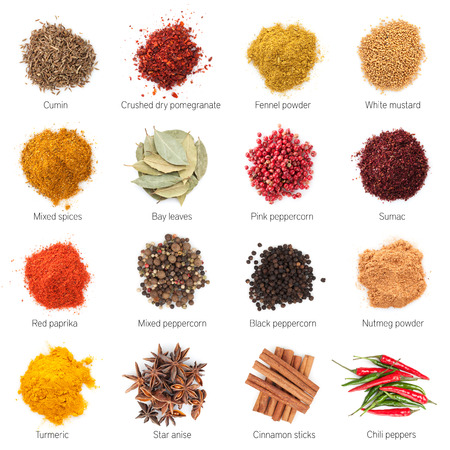 Different spices. Isolated on white background photo