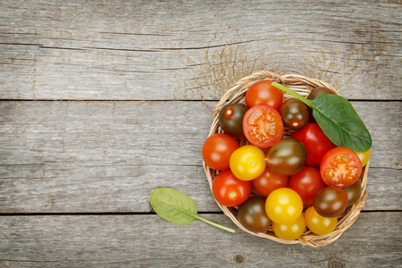 space wood: Colorful cherry tomatoes on wooden table background with copy space Stock Photo