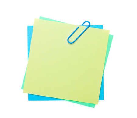 Colorful notes with clip. Isolated on white background
