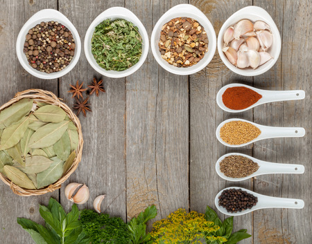 dill seed: Colorful herbs and spices selection. Aromatic ingredients on wood table with copyspace Stock Photo