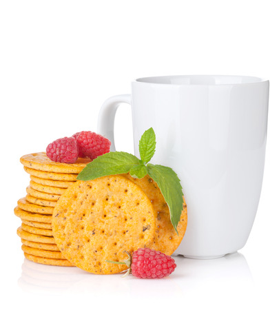 Stack of crackers with mint, berries and cup of drink. Isolated on white background photo
