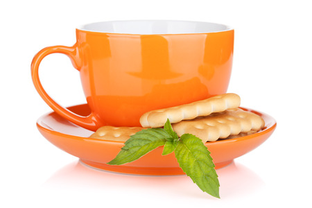 Cup of drink with crackers and mint. Isolated on white background photo