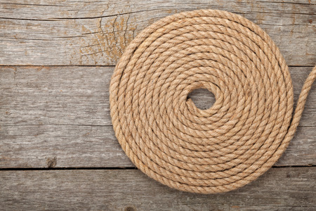 western border: Ship rope on old wooden texture background